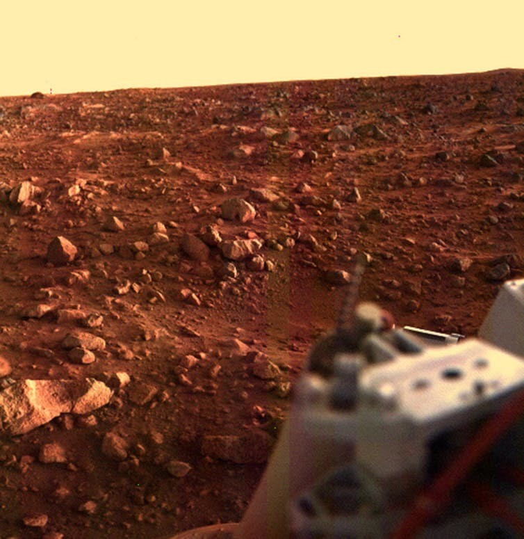 This colour image of the Martian surface was taken by Viking Lander 1, looking southwest, about 15 minutes before sunset