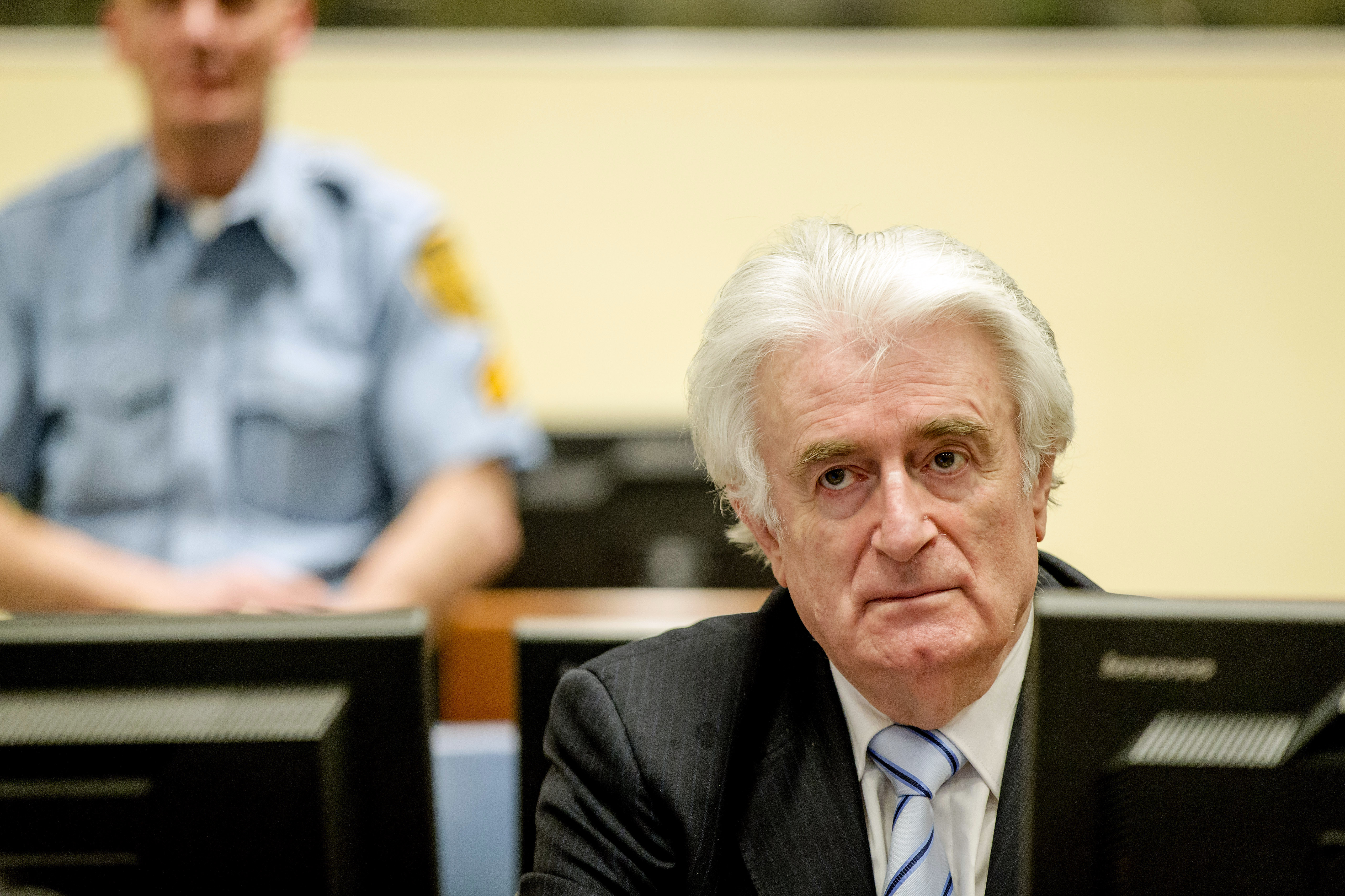 Ex-Bosnian Serb leader Radovan Karadzic sits in the court of the International Criminal Tribunal for former Yugoslavia (ICTY) in the Hague