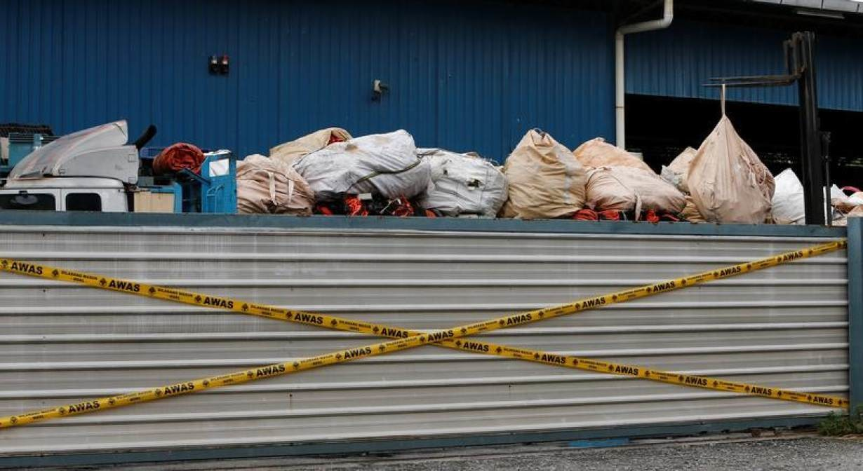 Plastic waste are piled on a truck in an illegal recycling factory sealed off by the authorities in Jenjarom, Kuala Langat, Malaysia October 14, 2018.