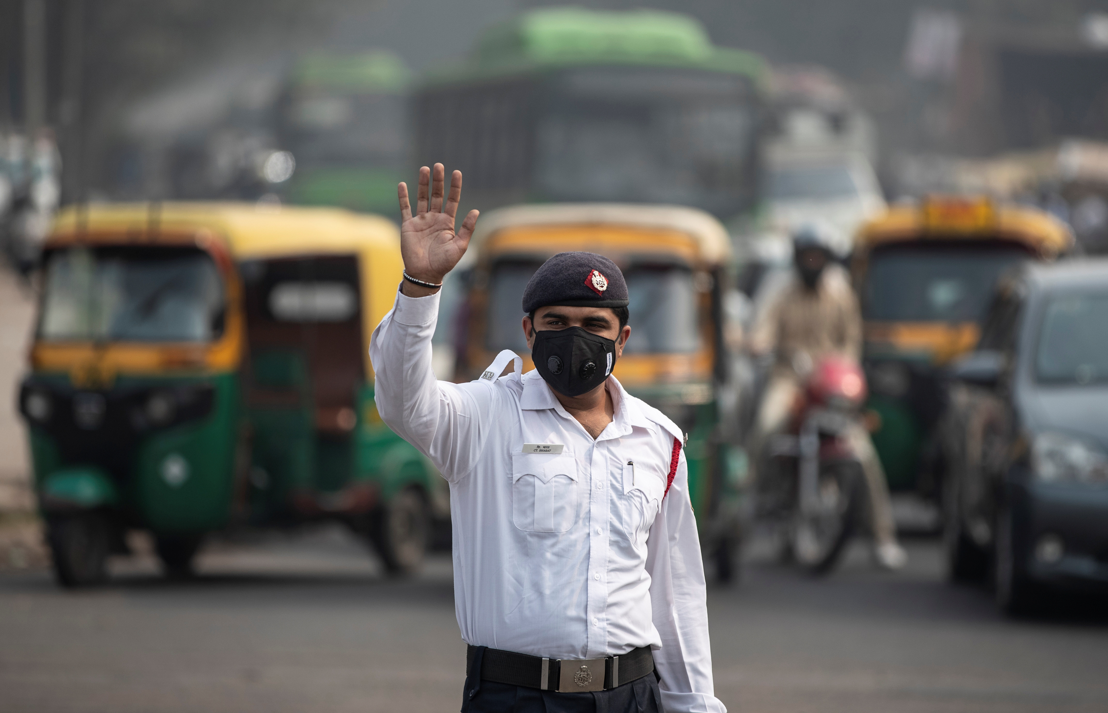 A traffic policeman wears a mask to protect himself from air pollution in New Delhi, India.