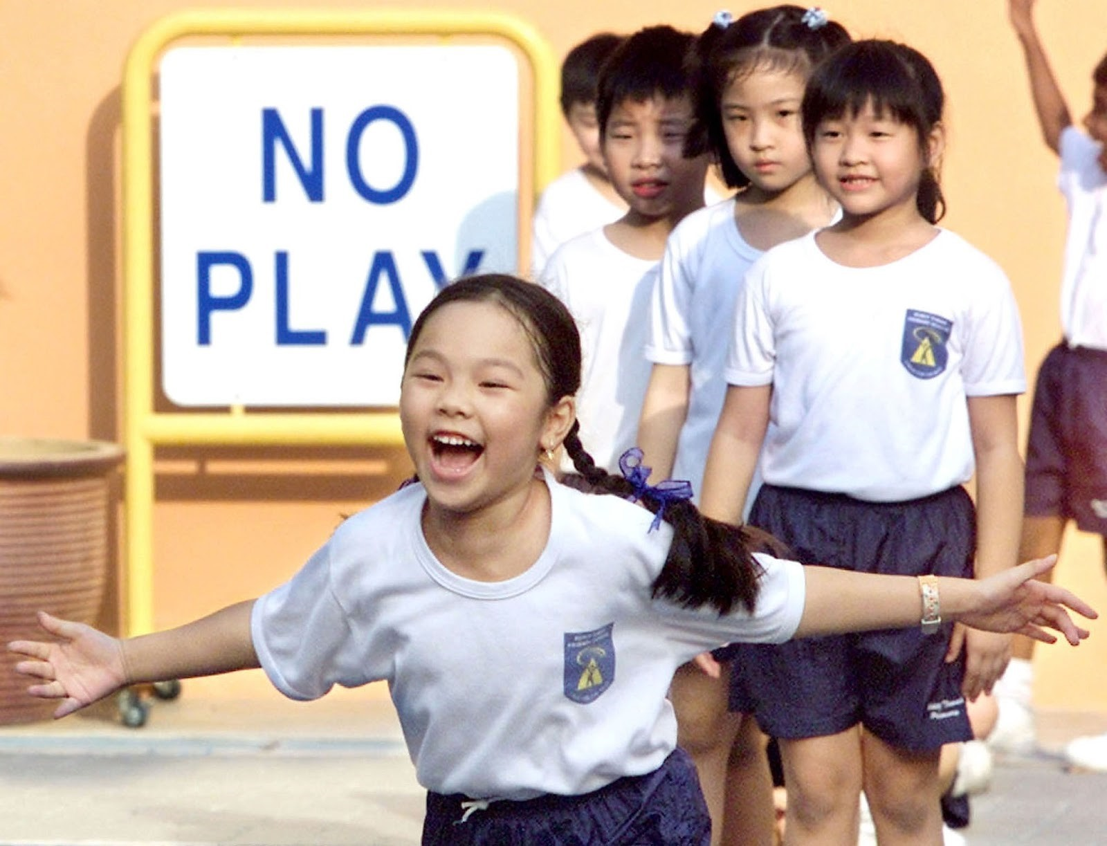Almost all Singaporean children can expect to achieve basic levels of proficiency at school.