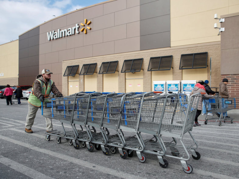 FILE PHOTO: An employee pushes shopping carts outside a Walmart store in Chicago, Illinois, U.S., November 20, 2018. REUTERS/Kamil Krzaczynski/File Photo