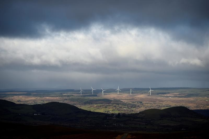 The hills in the foreground shadows marks the exact border between Ireland and Northern Ireland between County Cavan where windmills are visible and County Fermanagh near Florencecourt, Northern Ireland, November 30, 2017. REUTERS/Clodagh Kilcoyne - RC1BD9BBFFE0