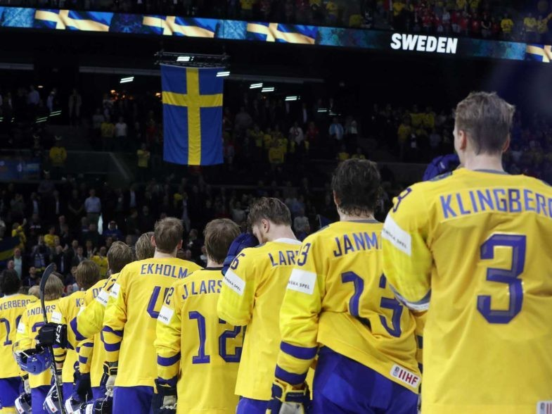Ice Hockey - 2018 IIHF World Championships - Semifinals - Sweden v USA - Royal Arena - Copenhagen, Denmark - May 19, 2018 - Team Sweden listen to the national anthem after winning a match. REUTERS/Grigory Dukor