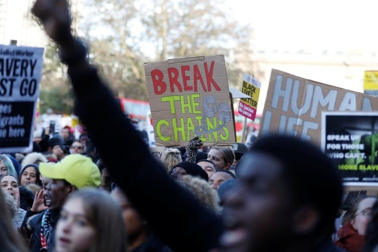 Demonstrators protest against slavery outside the Libyan embassy in London, December 2017.