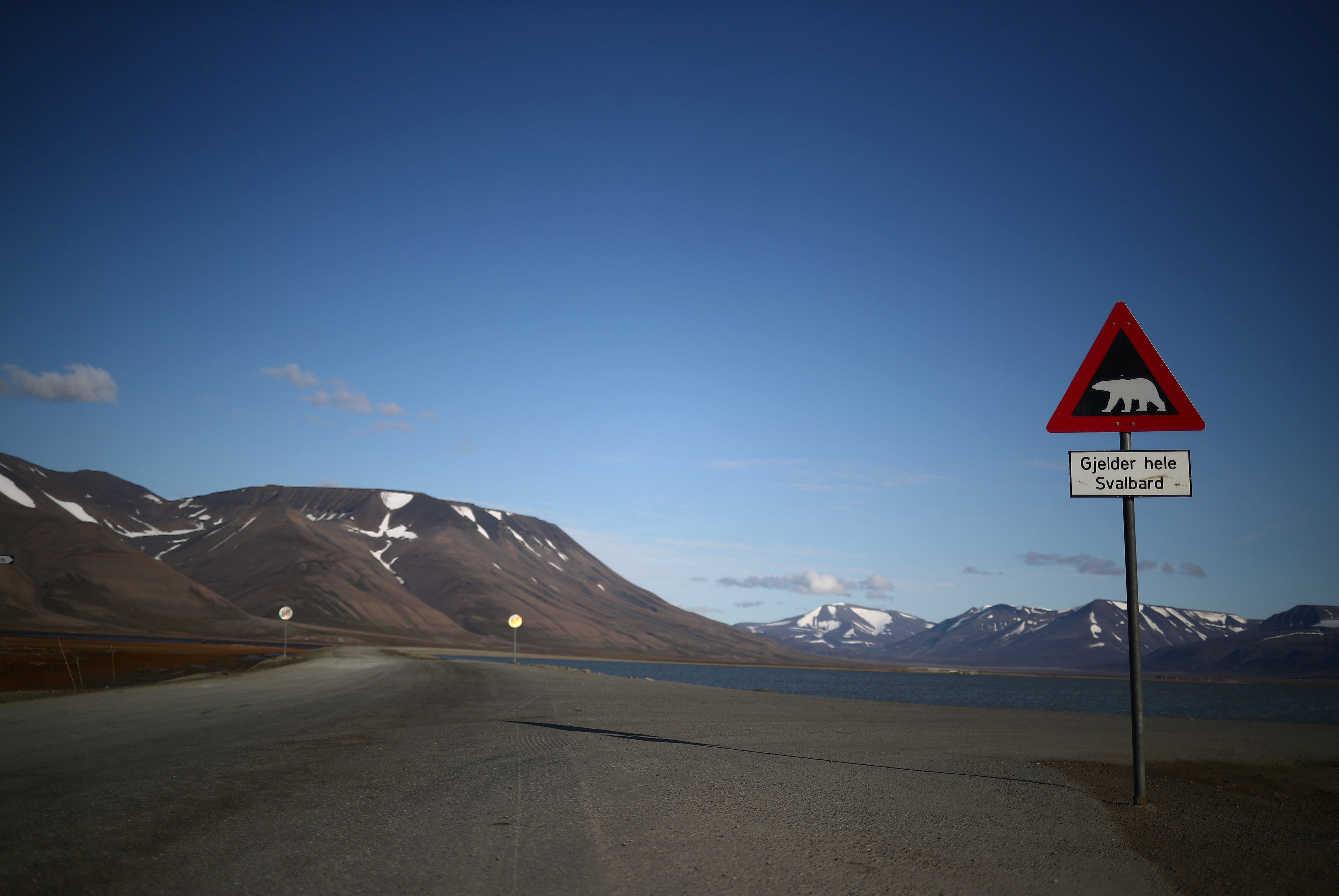 A sign warns of the danger from polar bears in the town of Longyearbyen in Svalbard, Norway, August 3, 2019. REUTERS/Hannah McKay    SEARCH