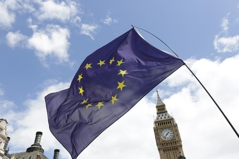 A European Union flag is held in front of the Big Ben clock tower in Parliament Square during a 'March for Europe' demonstration against Britain's decision to leave the European Union, central London, Britain July 2, 2016. Britain voted to leave the European Union in the EU Brexit referendum.