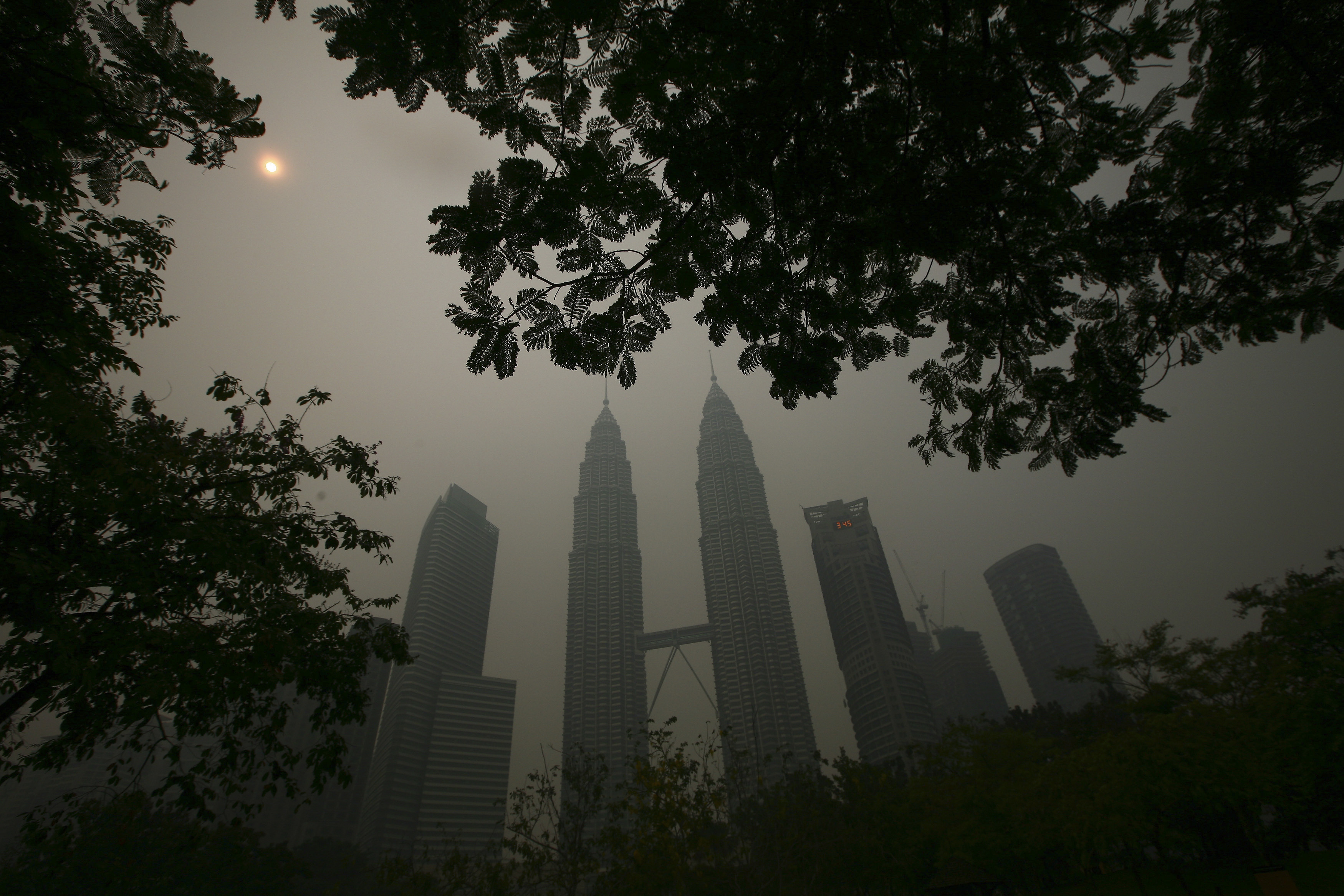 A view of the Kuala Lumpur city centre covered by haze in Kuala Lumpur March 3, 2014. Thick haze blanketing parts of Indonesia's Riau province continued to ground helicopters and obstruct water bombing efforts, while Malaysia saw a return to hazy conditions on Sunday.