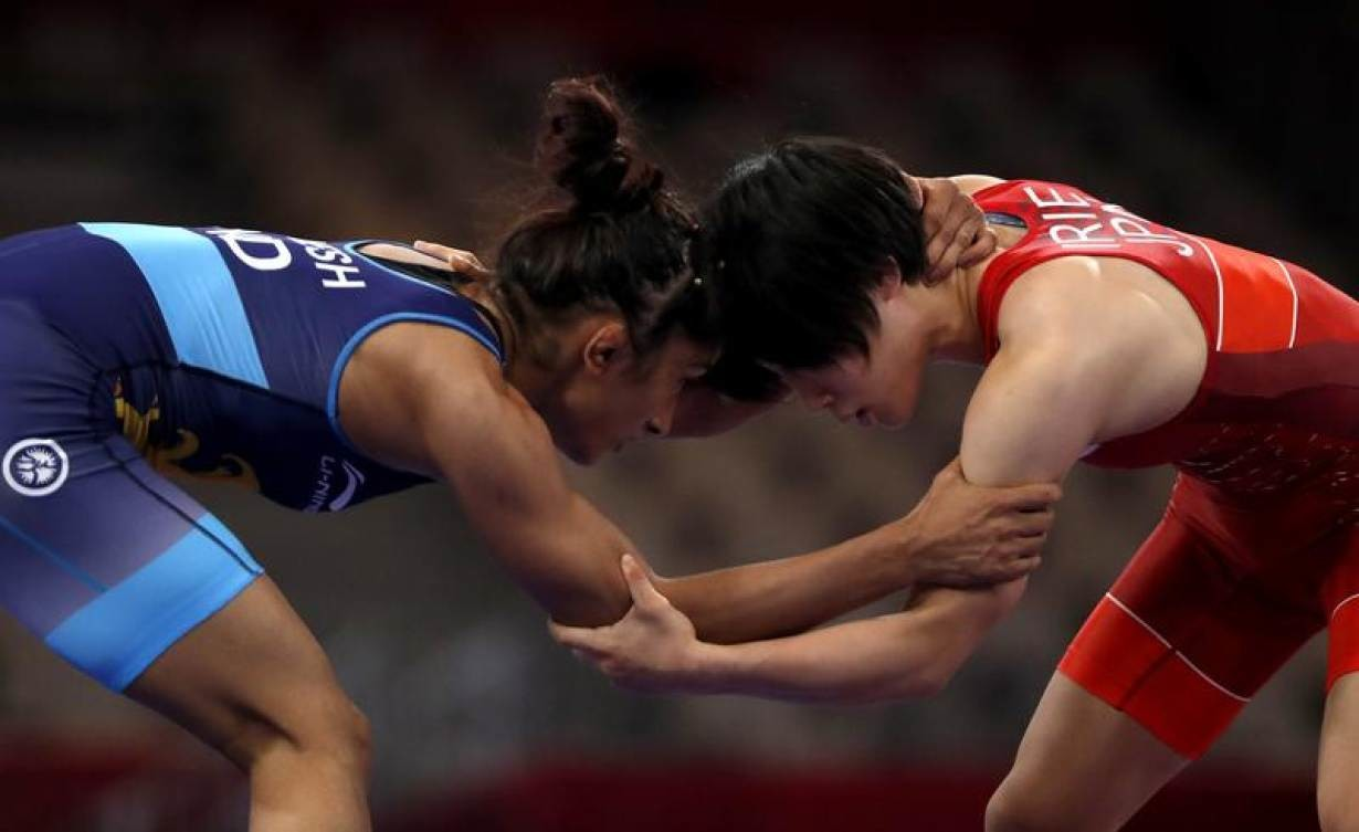 Wrestling - 2018 Asian Games – Women's Freestyle 50 kg Gold Medal Final - JCC – Assembly Hall - Jakarta, Indonesia – August 20, 2018 – Yuki Irie of Japan in action with Vinesh Vinesh of India.