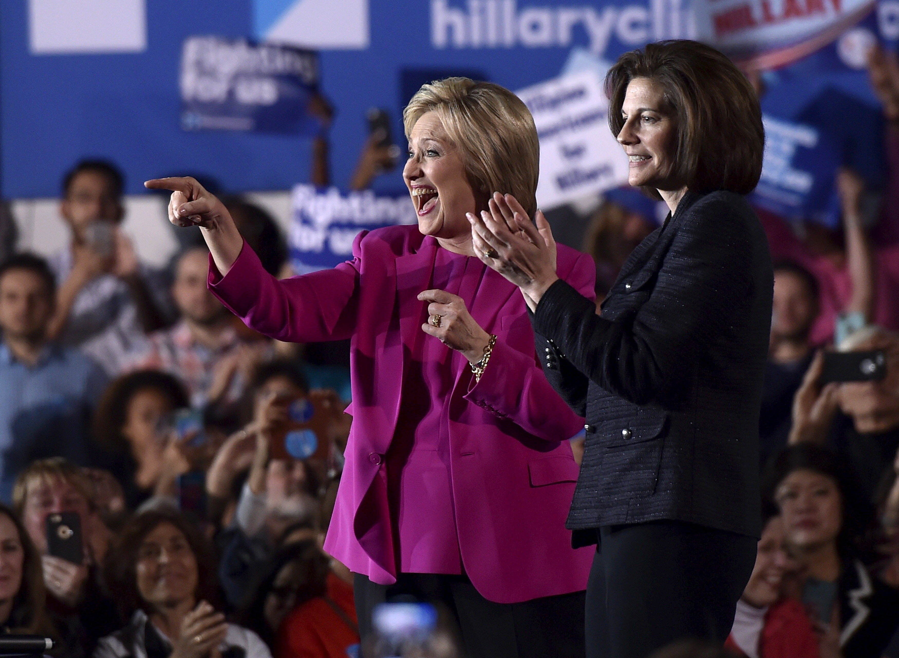U.S. Democratic presidential candidate Hillary Clinton (L) appears on stage with Nevada Senate candidate Catherine Cortez Masto at a campaign rally at the Laborers International Union hall in Las Vegas, Nevada February 18, 2016.