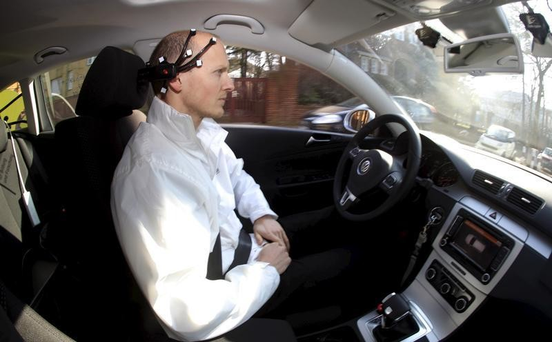 Daniel Goehring, of the AutoNOMOS research team of the Artificial Intelligence Group at the Freie Universitaet (Free University), demonstrates hands-free driving of the research car named 'MadeInGermany' during a test in Berlin, Germany February 28, 2011. To match Special Report AUTOS-DRIVERLESS/   REUTERS/Fabrizio Bensch/File Photo - RTX2BPMZ