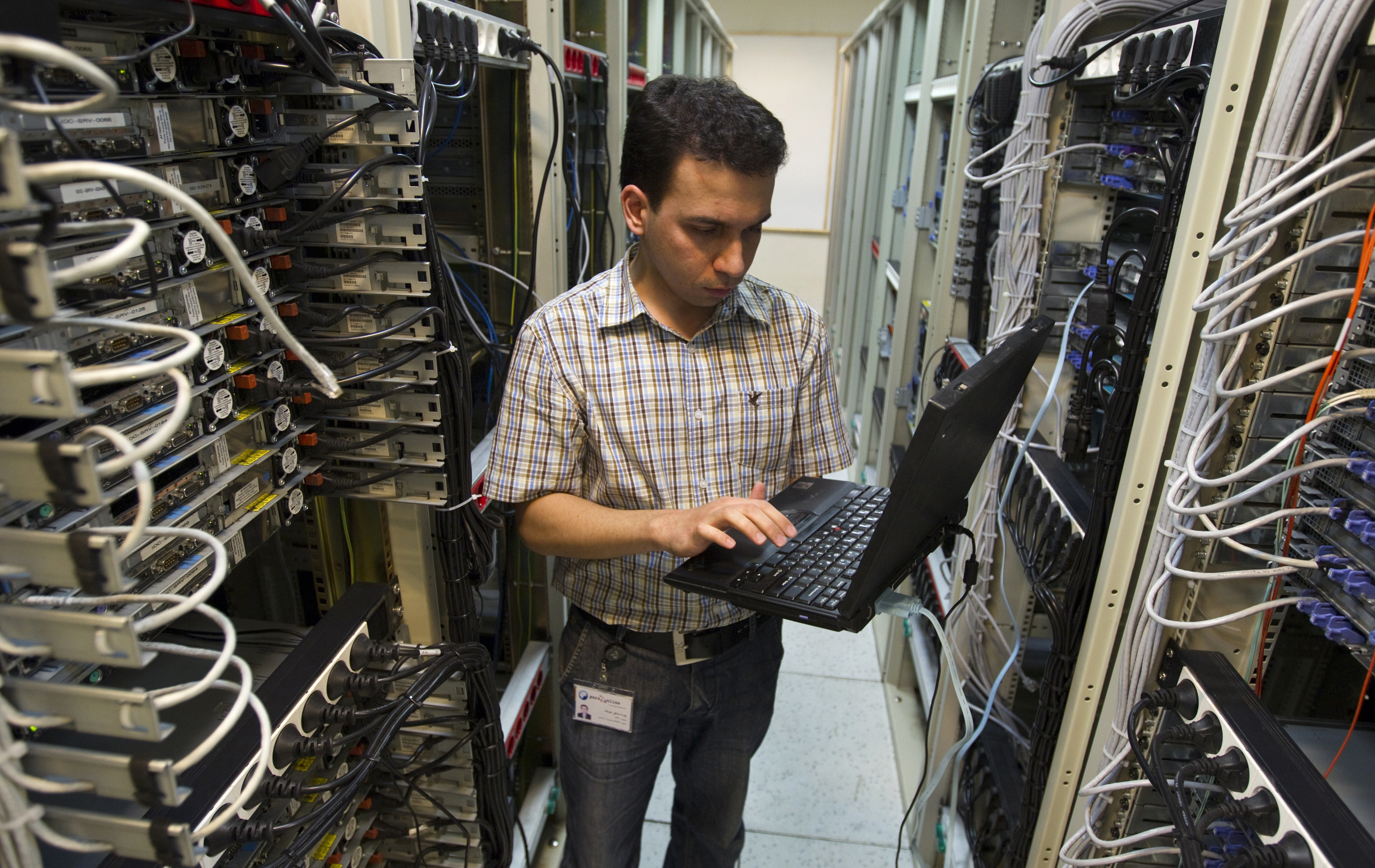 A computer engineer checks equipment at an internet service provider in Tehran February 15, 2011. Websites like Facebook, Twitter, YouTube and countless others were banned shortly after the re-election of Iran's President Mahmoud Ahmadinejad and the huge street protests that followed. Seen by the government as part of a