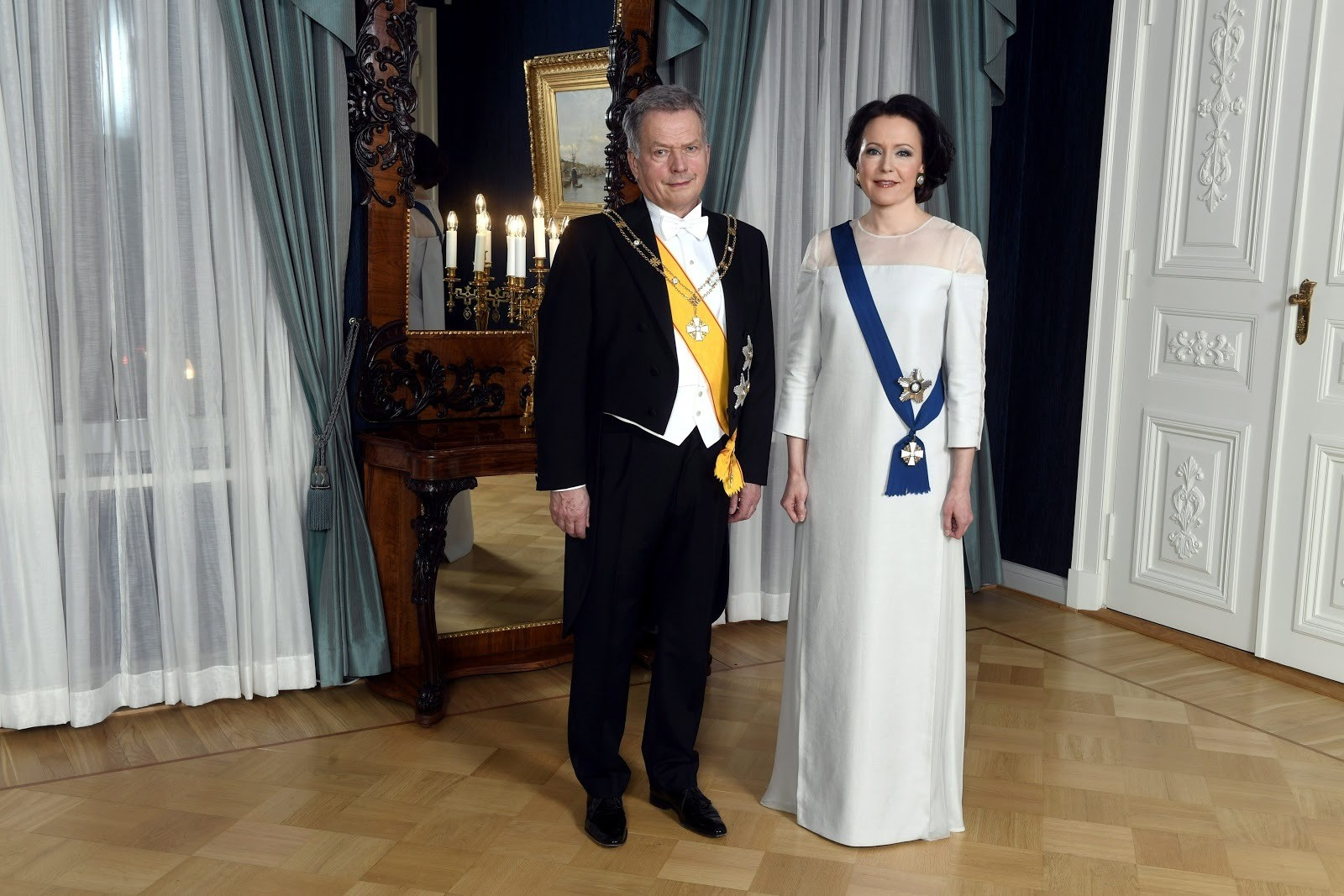 Finland's President Sauli Niinisto and his wife Jenni Haukio pose for a photograph ahead of the Independence Day reception in Helsinki, Finland December 6, 2018. Vesa Moilanen/Lehtikuva/via REUTERS ATTENTION EDITORS - THIS IMAGE WAS PROVIDED BY A THIRD PARTY. NO THIRD PARTY SALES. NOT FOR USE BY REUTERS THIRD PARTY DISTRIBUTORS. FINLAND OUT. NO COMMERCIAL OR EDITORIAL SALES IN FINLAND. - RC1C283F07E0