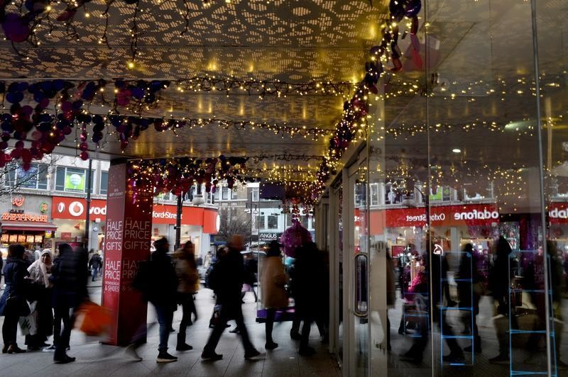 People shop before Christmas on Oxford Street in London
