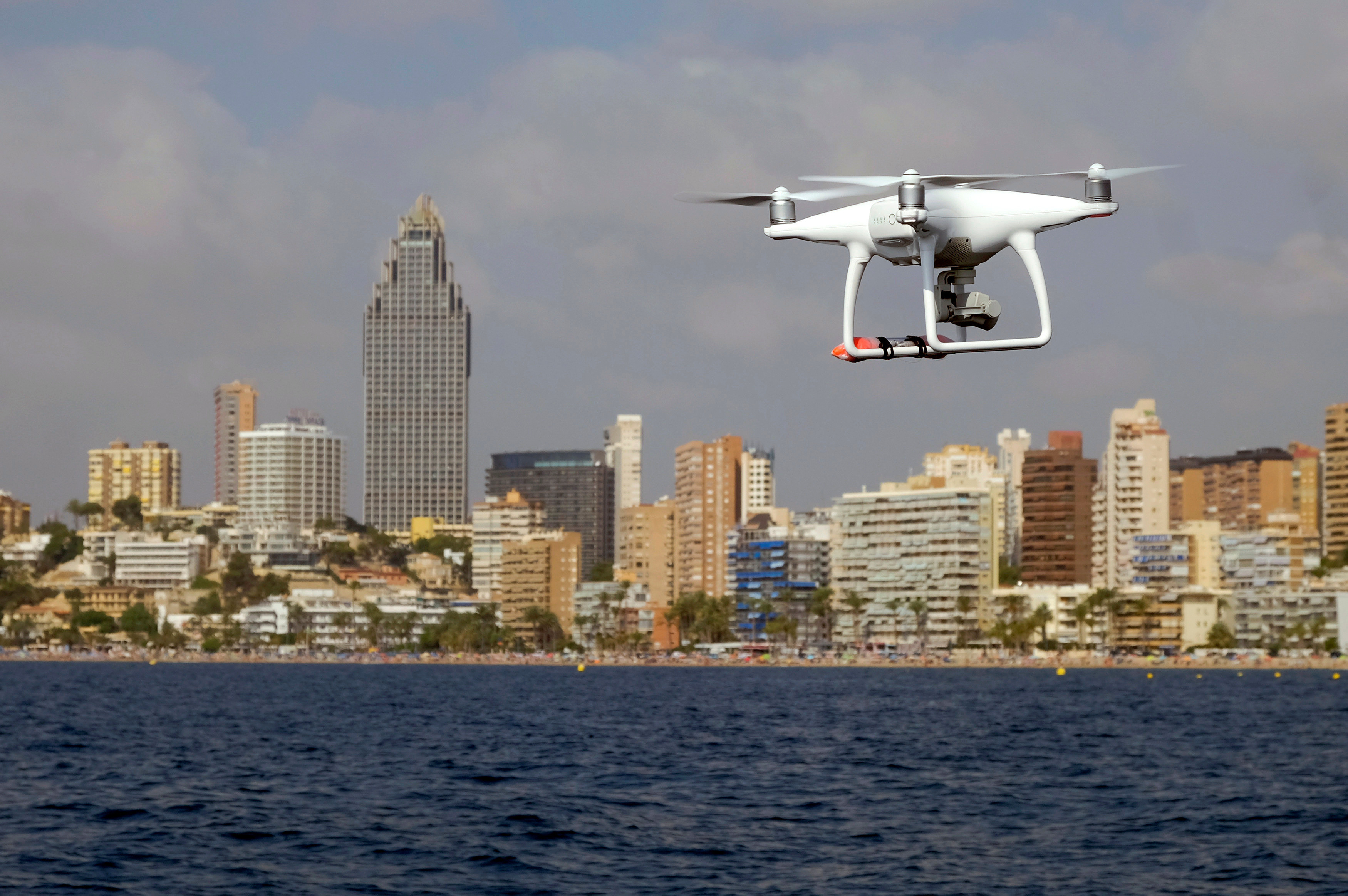 A drone, equipped with a camera used by police for surveillance tasks, flies in front of Poniente beach at the eastern costal town of Benidorm, Spain, August 18, 2016. REUTERS/Heino Kalis - RTX2LU83