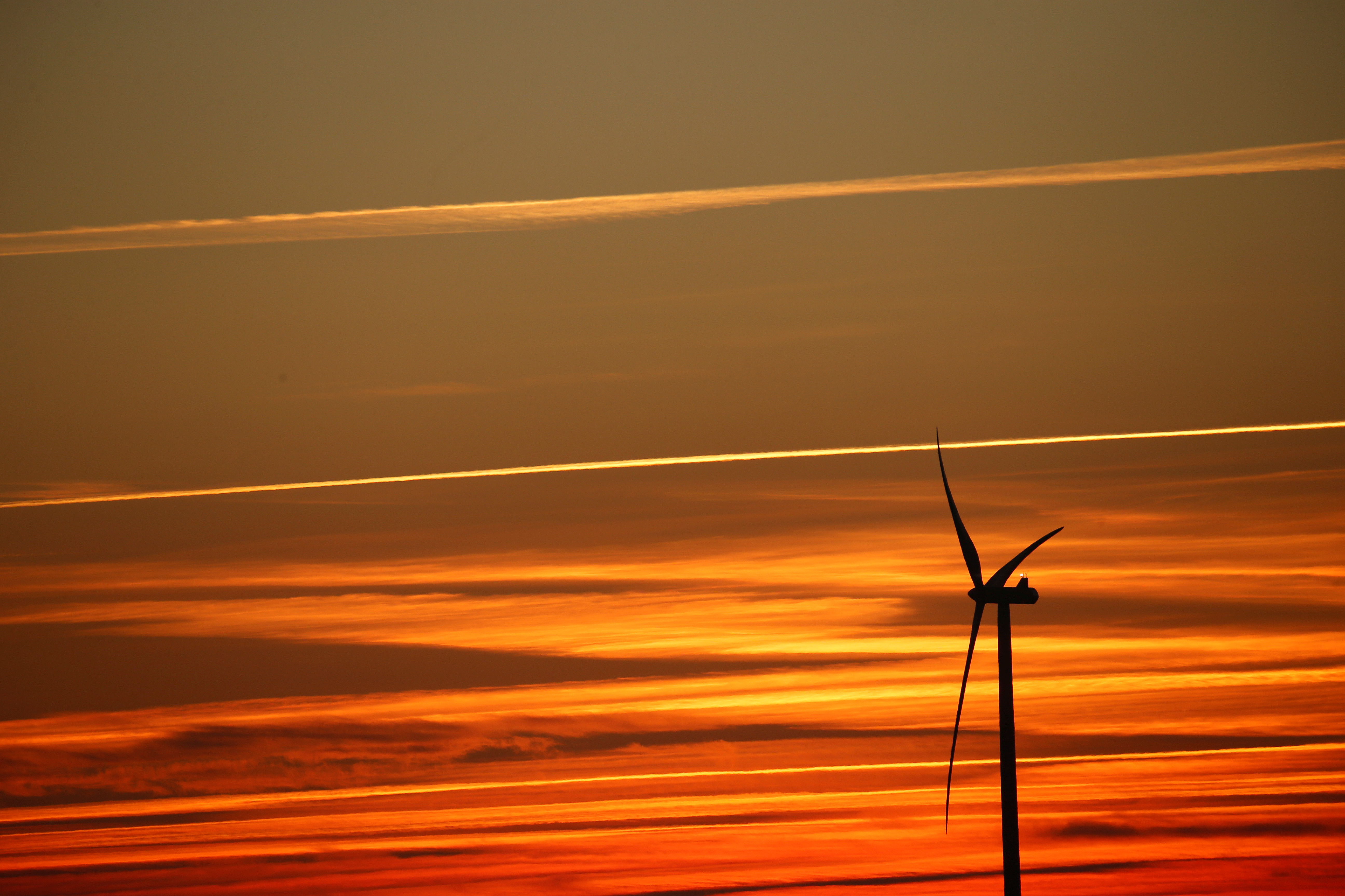 Power-generating windmill turbines are pictured at sunset at a wind park in Nurlu near Cambrai, France.