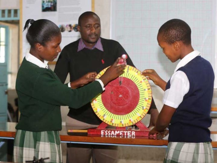Peter Tabichi and his students show their prize winning project.