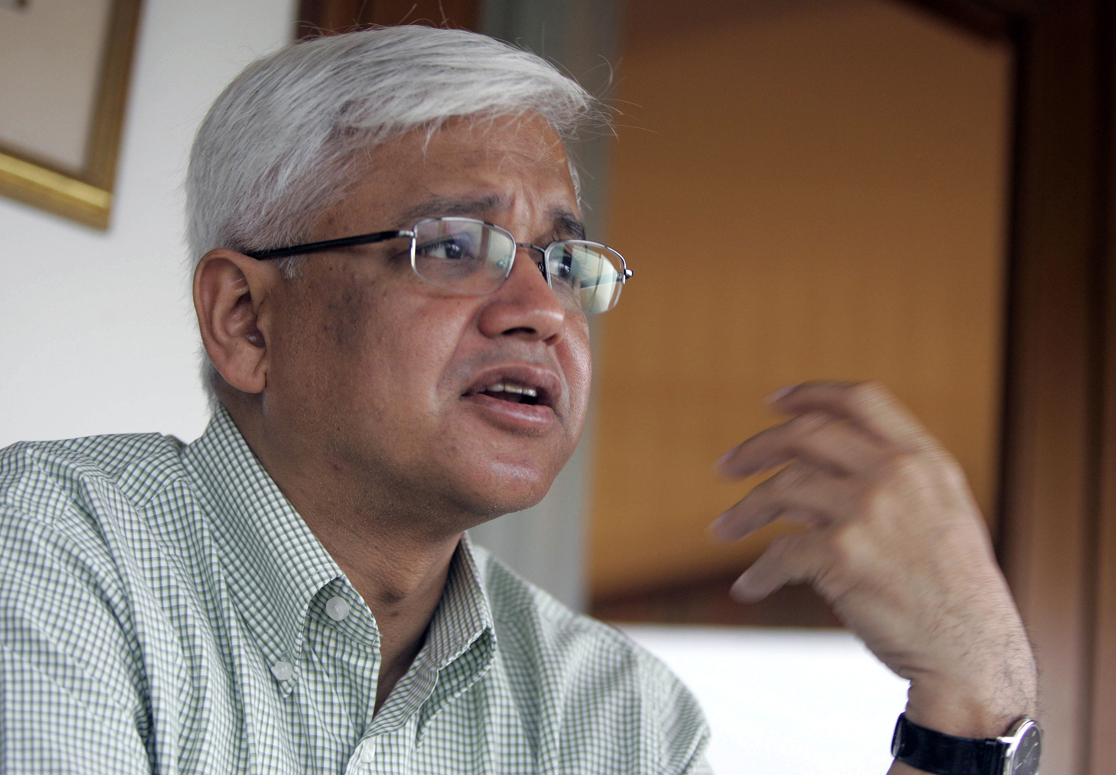 Indian author Amitav Ghosh speaks during an interview with Reuters at a hotel in New Delhi June 15, 2008. More than 20 years after writing his first novel, Ghosh is still drawing on his favourite subjects of history and anthropology to weave his stories. His latest work,
