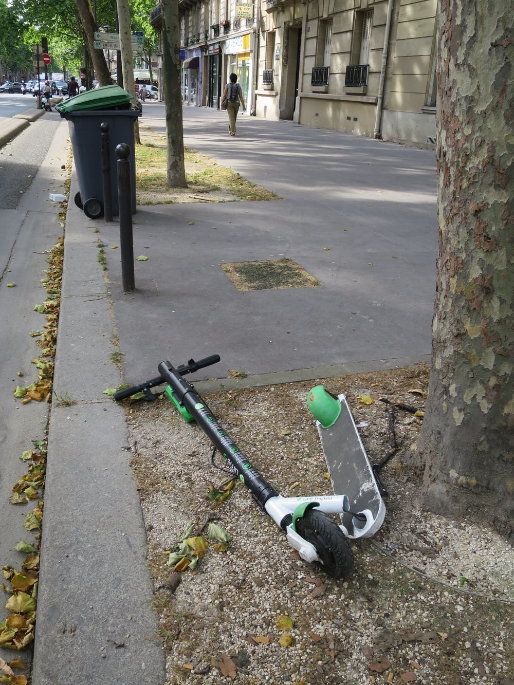 A snapped Lime lies abandoned in Paris. Attempting to speed their launch and minimise costs, e-mobility firms have often used off-the-shelf scooters that die quickly on city streets.