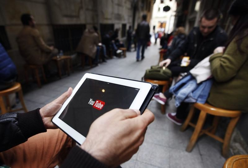 A man tries to get connected to the youtube web site with his tablet at a cafe in Istanbul March 27, 2014.