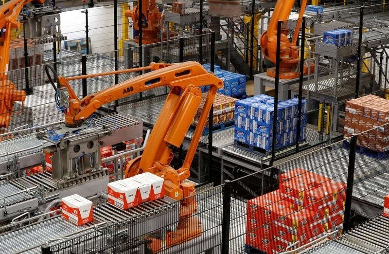 Robotic arms load biscuits onto pallets on the production line of Pladis' McVities factory in London Britain, September 19, 2017.  Picture taken September 19, 2017. REUTERS/Peter Nicholls. - RC1AFC5A2420