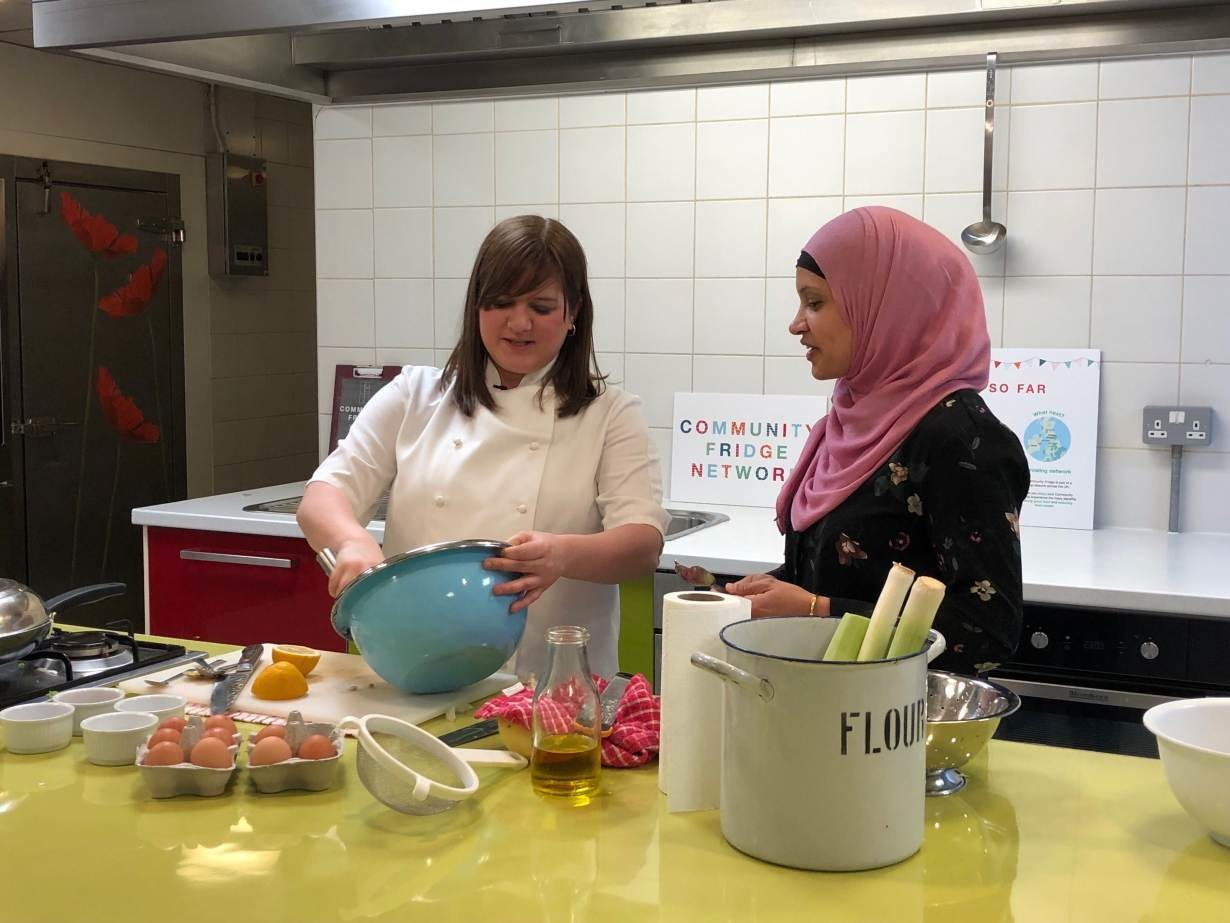 (Left to right) Chef Natalie Coleman and Manaza Nasa, volunteer at the Food Academy Community Fridge in the East Ham Leisure Centre, prepare a Spanish tortilla with products from the community fridge in London, United Kingdom, on March 6, 2019.