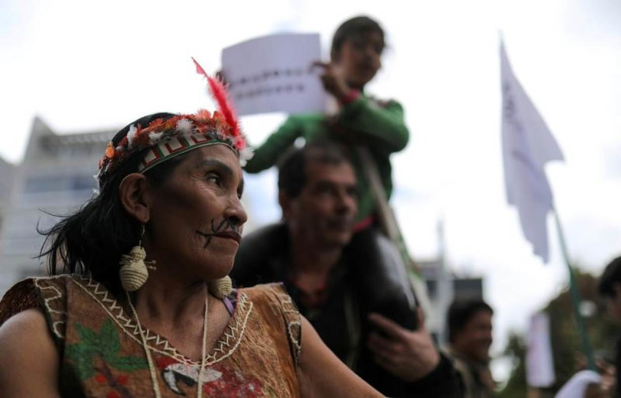 An indigenous woman looks on as she attends a protest outside the Brazilian embassy due to the wildfires in the Amazon rainforest, in Bogota, Colombia August 23, 2019.