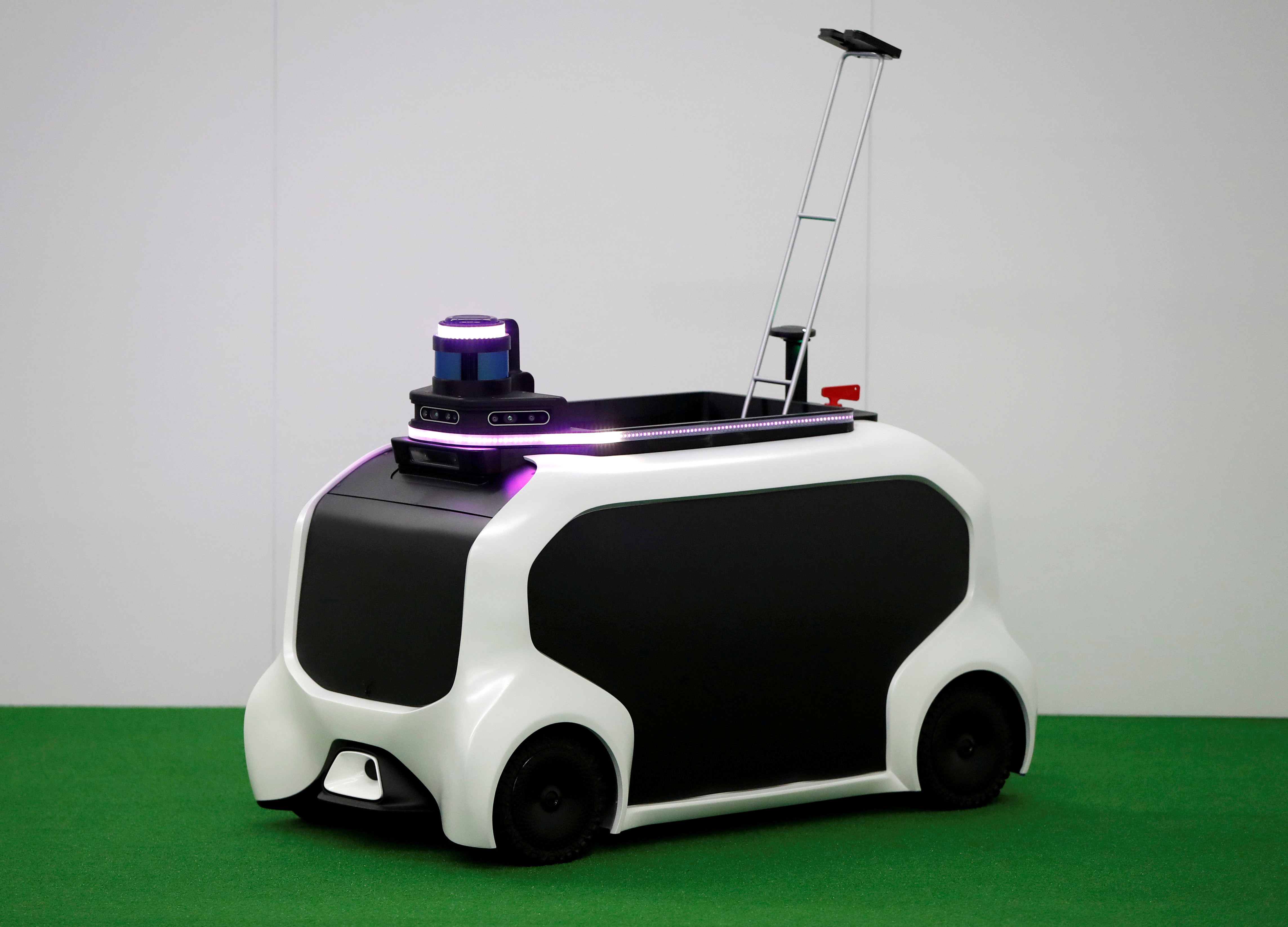 Toyota Motor Corp. demonstrates FRS field event support robot which will be used to support the Tokyo 2020 Olympic and Paralympic Games, during a press preview in Tokyo, Japan July 18, 2019. Picture taken July 18, 2019.  REUTERS/Issei Kato - RC1A9C6F9000