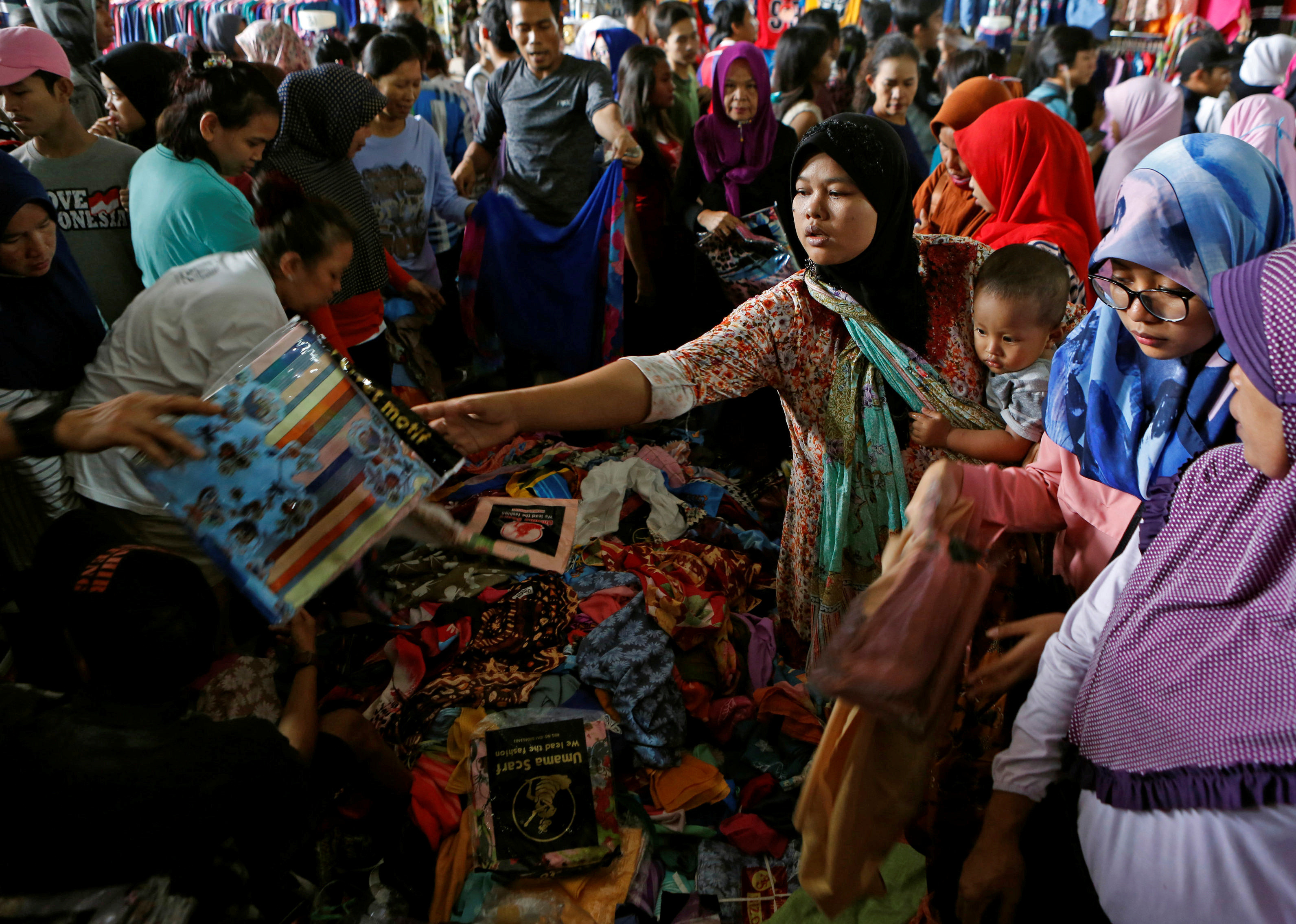 Shoppers at a Jakarta market ahead of the Muslim festival of Eid al-Fitr.