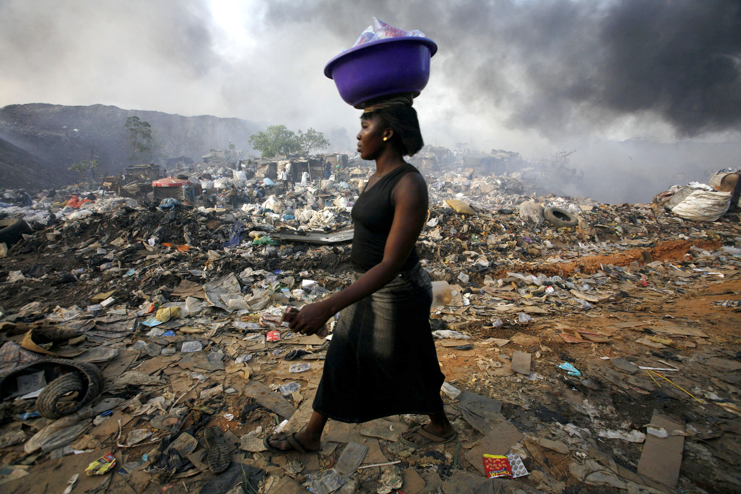 A woman walks through Olusosun rubbish dump in Nigeria's commercial capital Lagos.
