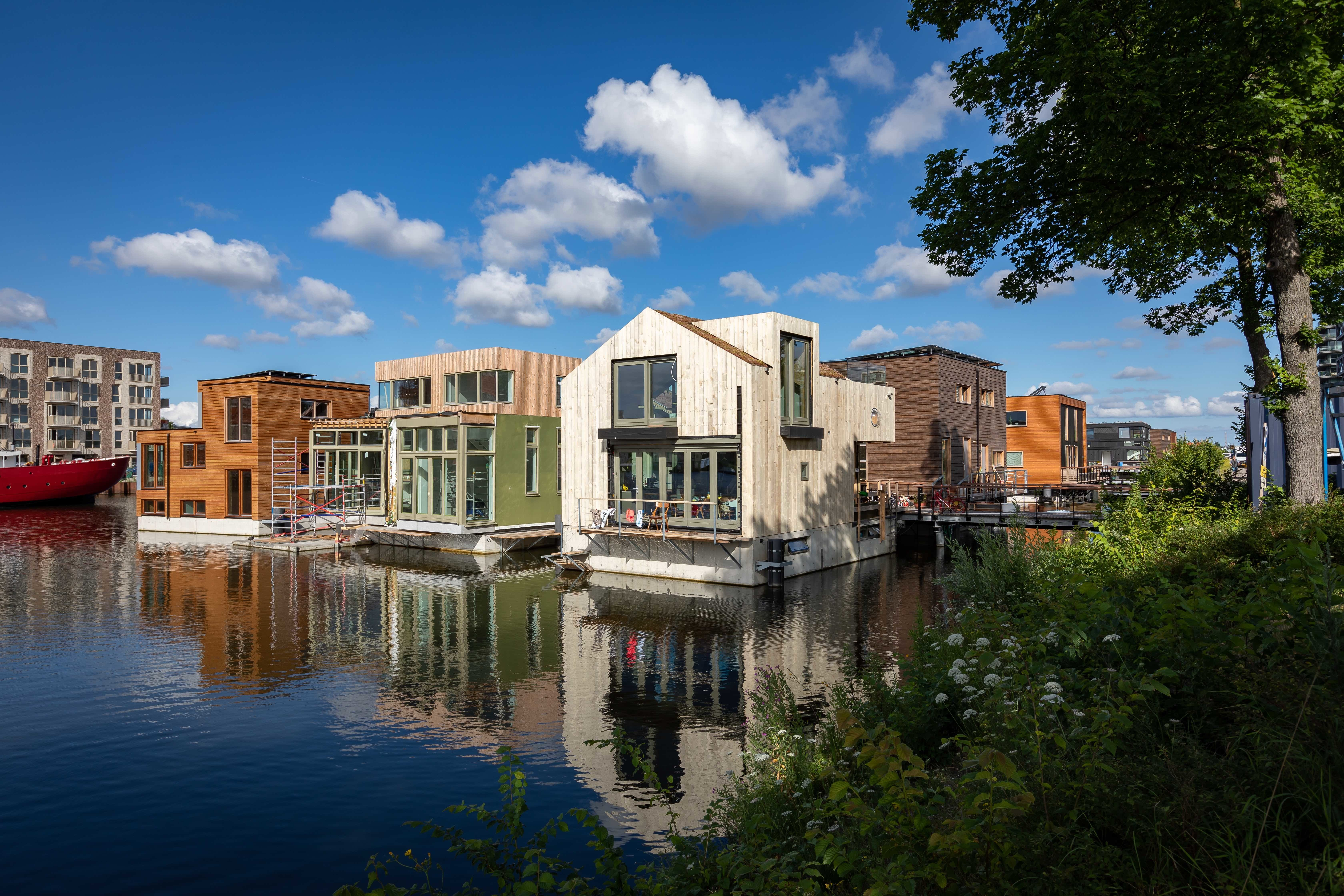 a picture of the houses in the Schoonschip block by the water