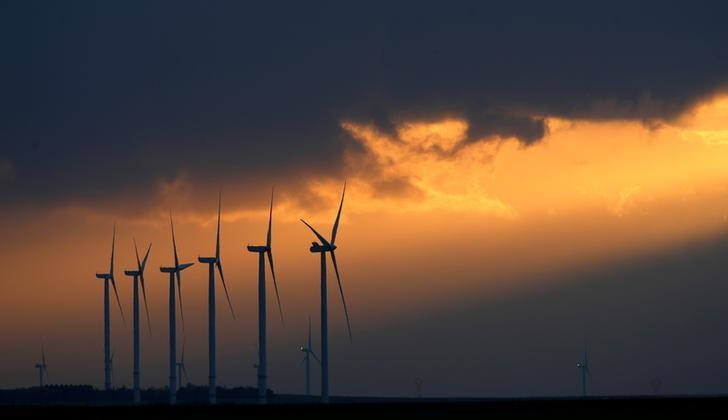 Power-generating windmill turbines are seen during sunset at a wind park near Reims, France, November 13, 2017. REUTERS/Christian Hartmann