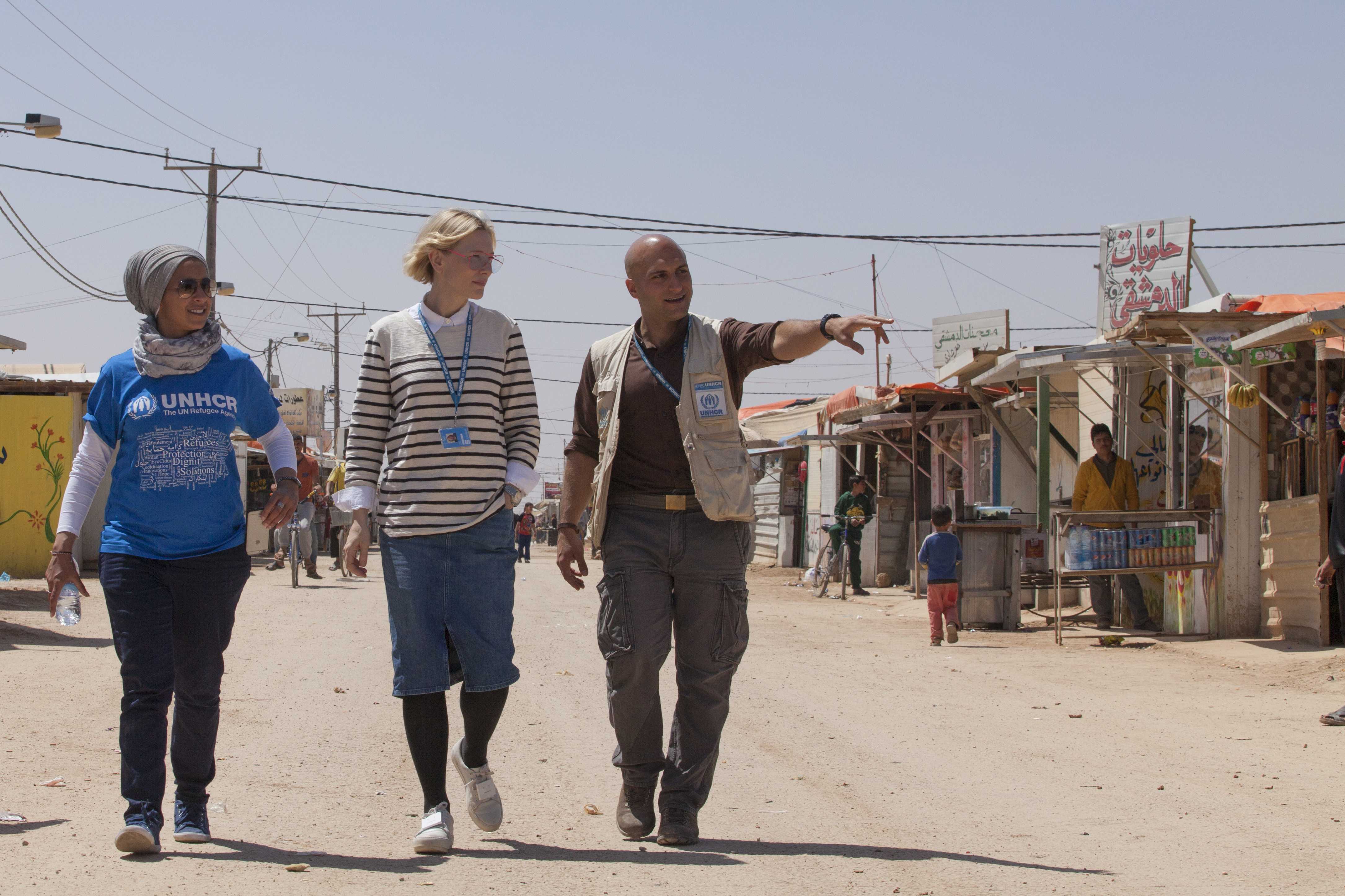 UNHCR Goodwill Ambassador Cate Blanchett and Camp Manager Hovig Etyemezian at Zaatari refugee camp walk Champs Elysees. Zaatari has 3000 shops throughout the camp, many of which are located on this main road. ; UNHCR Goodwill Ambassador Cate Blanchett visits Syrian refugees in Jordan