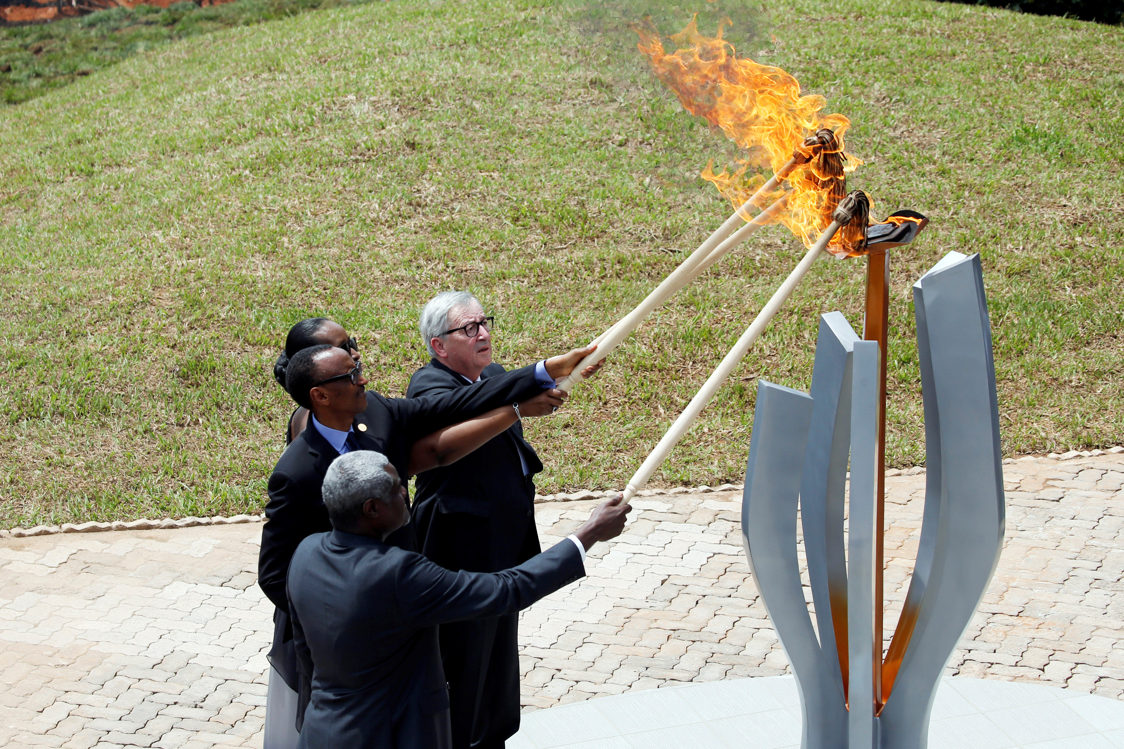 African Union Commission Chairperson Moussa Faki Mahamat, Rwandan President Paul Kagame, Jeannette Kagame and European Commission President Jean-Claude Juncker, light the flame of hope during a commemoration ceremony of the 25th anniversary of the genocide at the Genocide Memorial in Gisozi in Kigali, Rwanda
