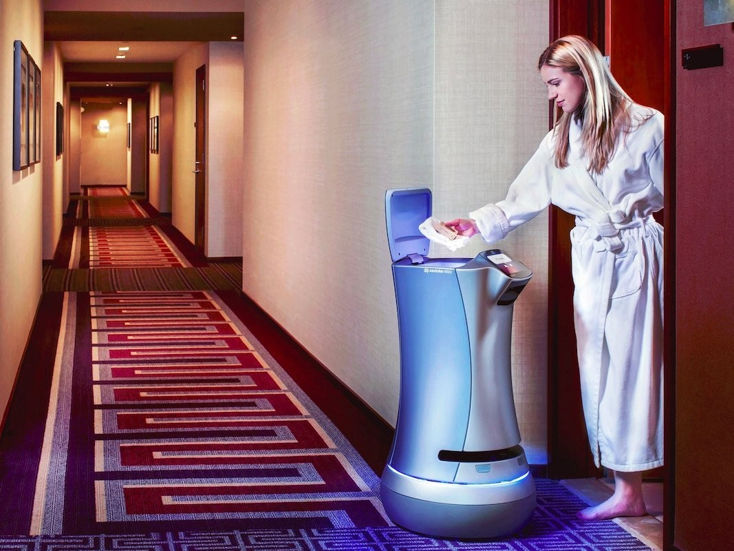 A robot from startup Savioke makes a room-service delivery at a hotel in Silicon Valley.