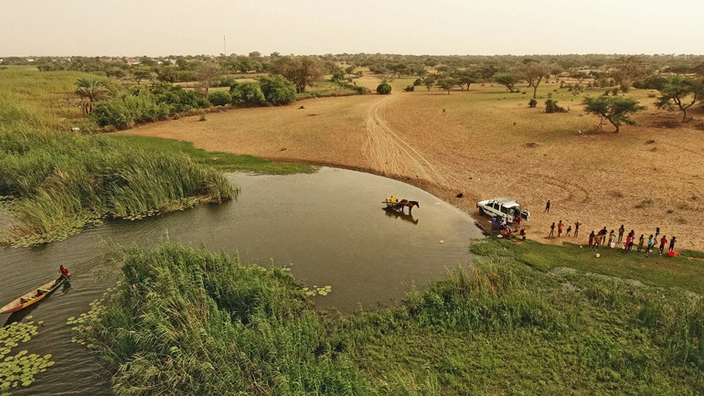 A village's river water access point, as seen from a drone, in northwestern Senegal. People use river waters for many purposes, including bathing, swimming, and washing dishes and clothes.