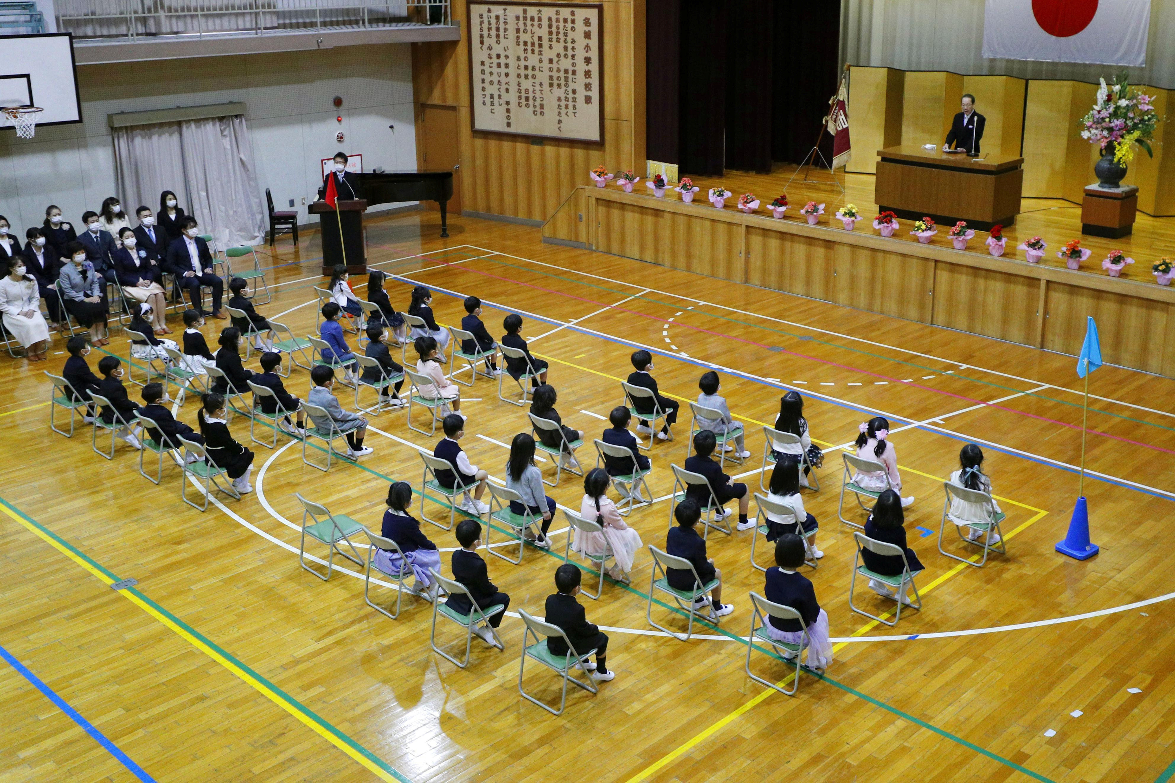 Children attend the entrance ceremony of an elementary school, following the outbreak of the coronavirus disease (COVID-19), in Nagoya, Japan, in this photo taken by Kyodo April 6, 2020. Mandatory credit Kyodo/via REUTERS ATTENTION EDITORS - THIS IMAGE WAS PROVIDED BY A THIRD PARTY. MANDATORY CREDIT. JAPAN OUT. NO COMMERCIAL OR EDITORIAL SALES IN JAPAN. - RC2RYF9IDEED