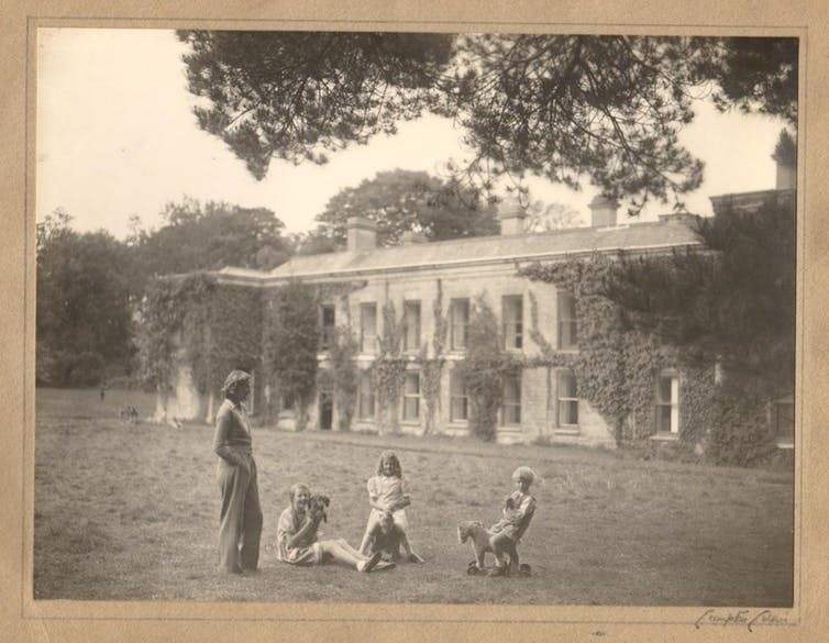 Du Maurier and her children at Menabilly, the house near Fowey in Cornwall in which she and her family lived for many years. The house was the inspiration for the novel Rebecca.