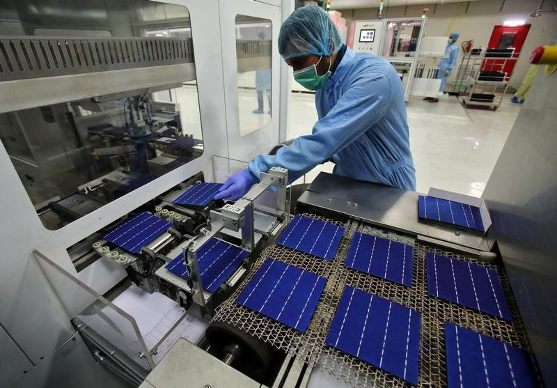 An employee works at a solar cell production line at Jupiter Solar Power Limited (JSPL) plant in Baddi, in the northern state of Himachal Pradesh, India May 29, 2017. Picture taken May 29, 2017. REUTERS/Ajay Verma - RC11E19D6400