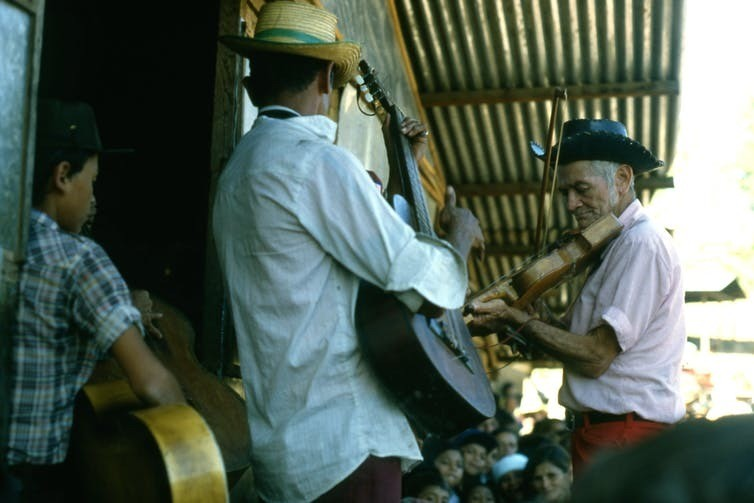 Salvadoran musicians performing at Colomoncagua refugee camp, Honduras, 1985, during a humanitarian visit by Canadian musician Bruce Cockburn. (Photo courtesy of Meyer Brownstone/Oxfam Canada.)