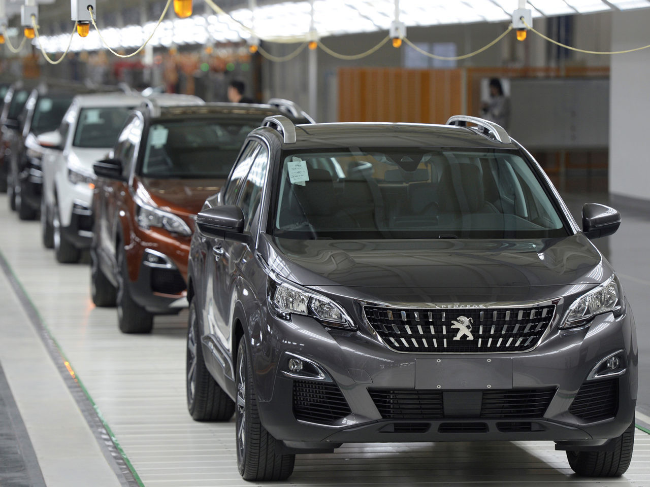 FILE PHOTO: Vehicles are seen at a Dongfeng Peugeot Citroen factory before it starts up production in Chengdu, Sichuan province, China, September 6, 2016. Picture taken September 6, 2016.China Daily/via REUTERS/File Photo   ATTENTION EDITORS - THIS IMAGE WAS PROVIDED BY A THIRD PARTY. CHINA OUT. NO COMMERCIAL OR EDITORIAL SALES IN CHINA.