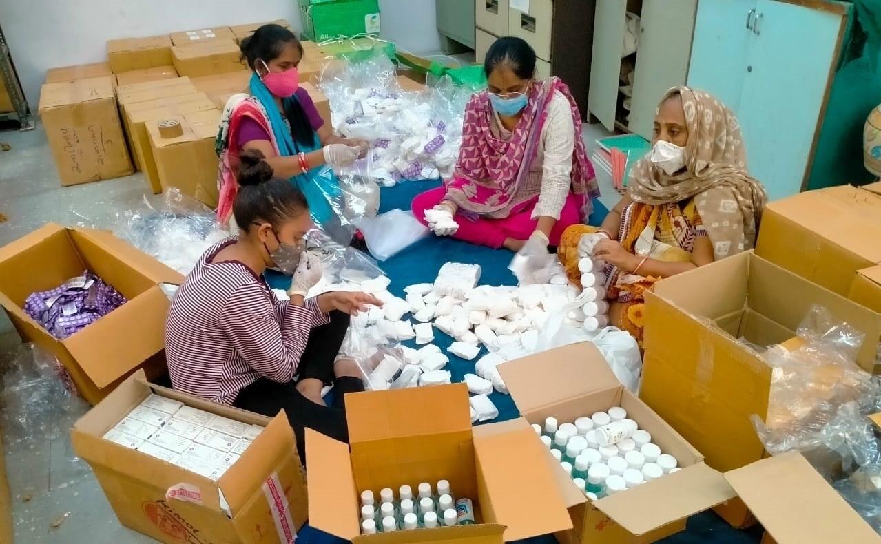 Women prepare community health kits