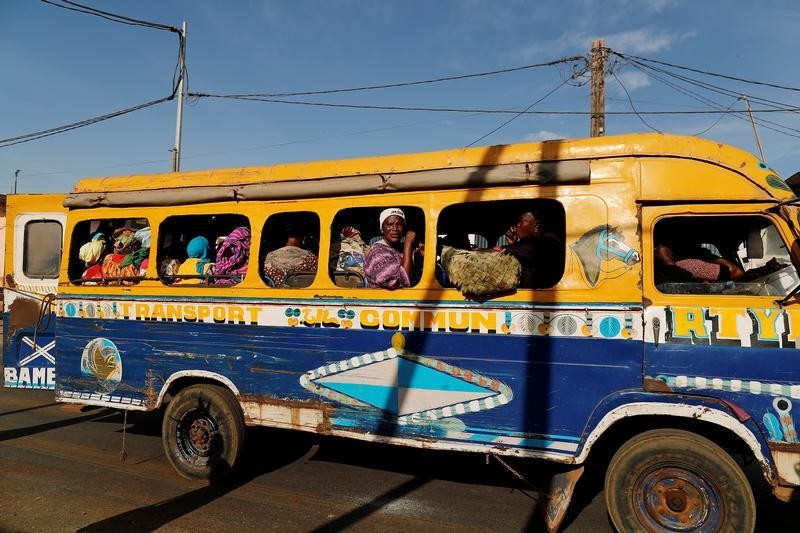 A woman looks out of a public transport bus called 'car rapide' in Pikine, on the outskirts of Dakar, Senegal February 1, 2019 REUTERS/Zohra Bensemra - RC1E1320CF80