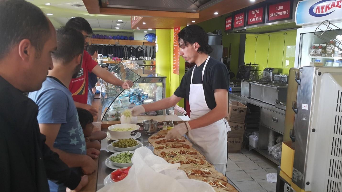 Khaled prepares falafels in the EKO station camp