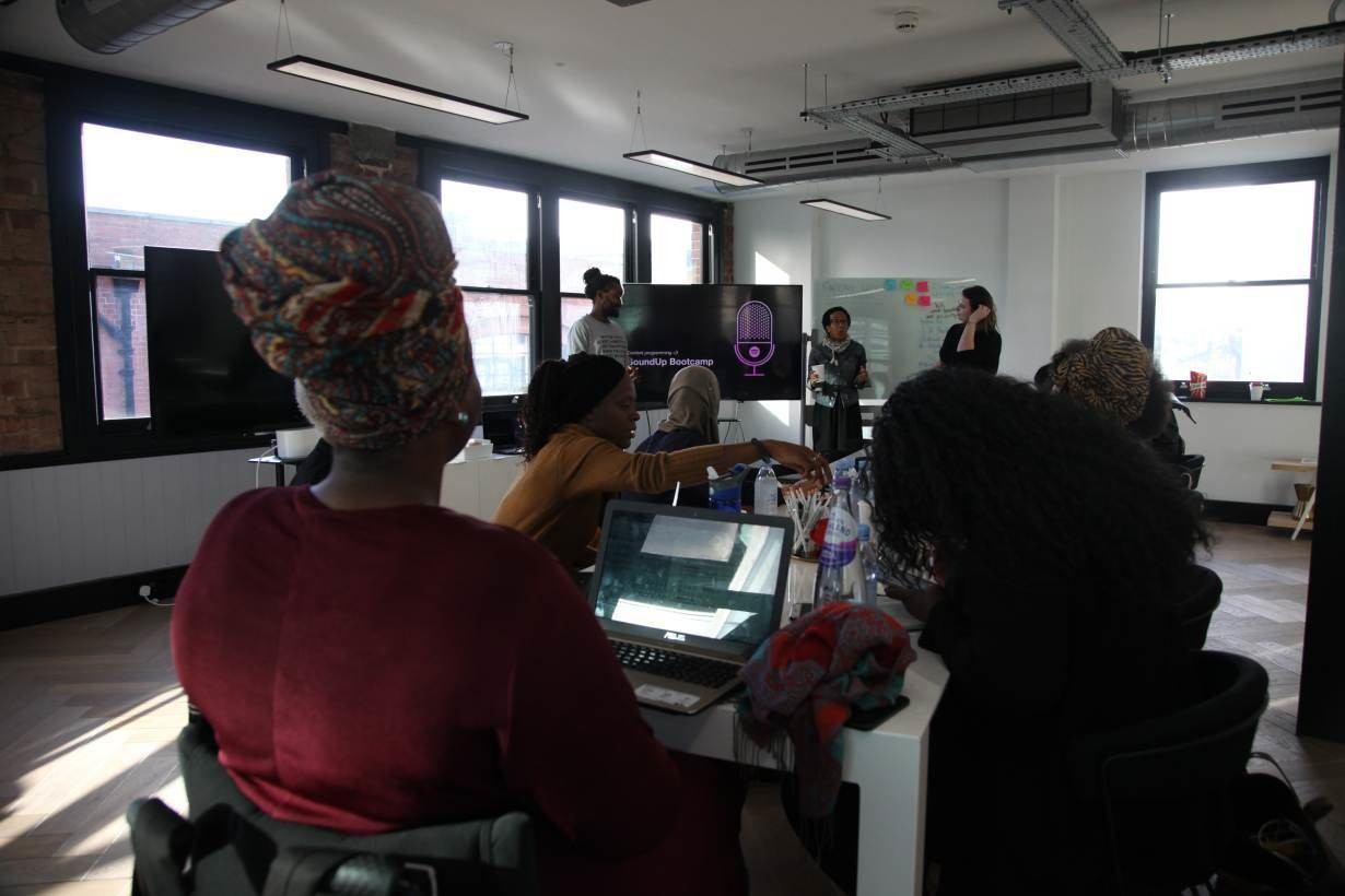 Women participate in podcasting bootcamp run by audio streaming company Spotify in central London, 8 November, 2018.