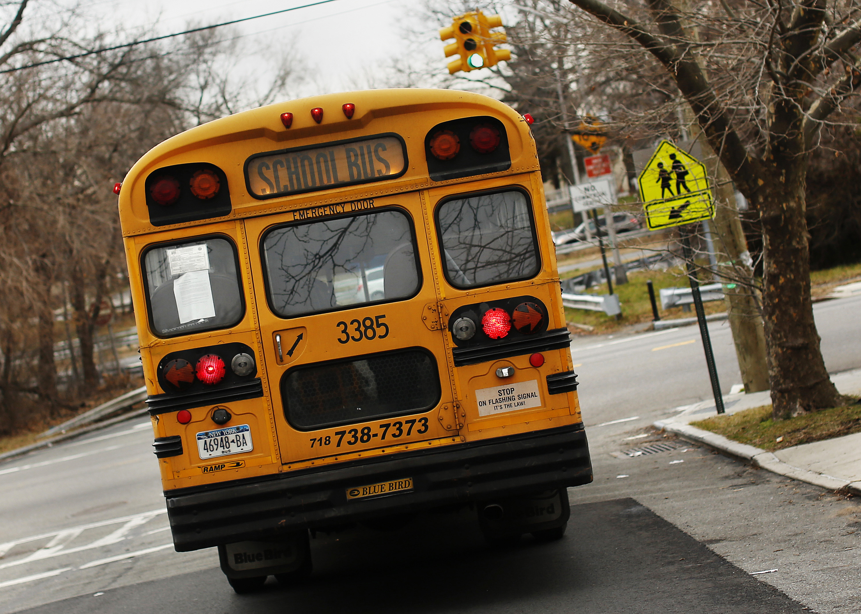 A school bus used for transporting New York City public school students is seen driving down 135th avenue in the Queens borough of New York January 15, 2013. New York City school bus drivers will go on strike on Wednesday, an action that Mayor Michael Bloomberg said would complicate the commute of more than 152,000 students in the nation's largest public school system. REUTERS/Shannon Stapleton (UNITED STATES - Tags: EDUCATION CIVIL UNREST) - GM1E91G07A901