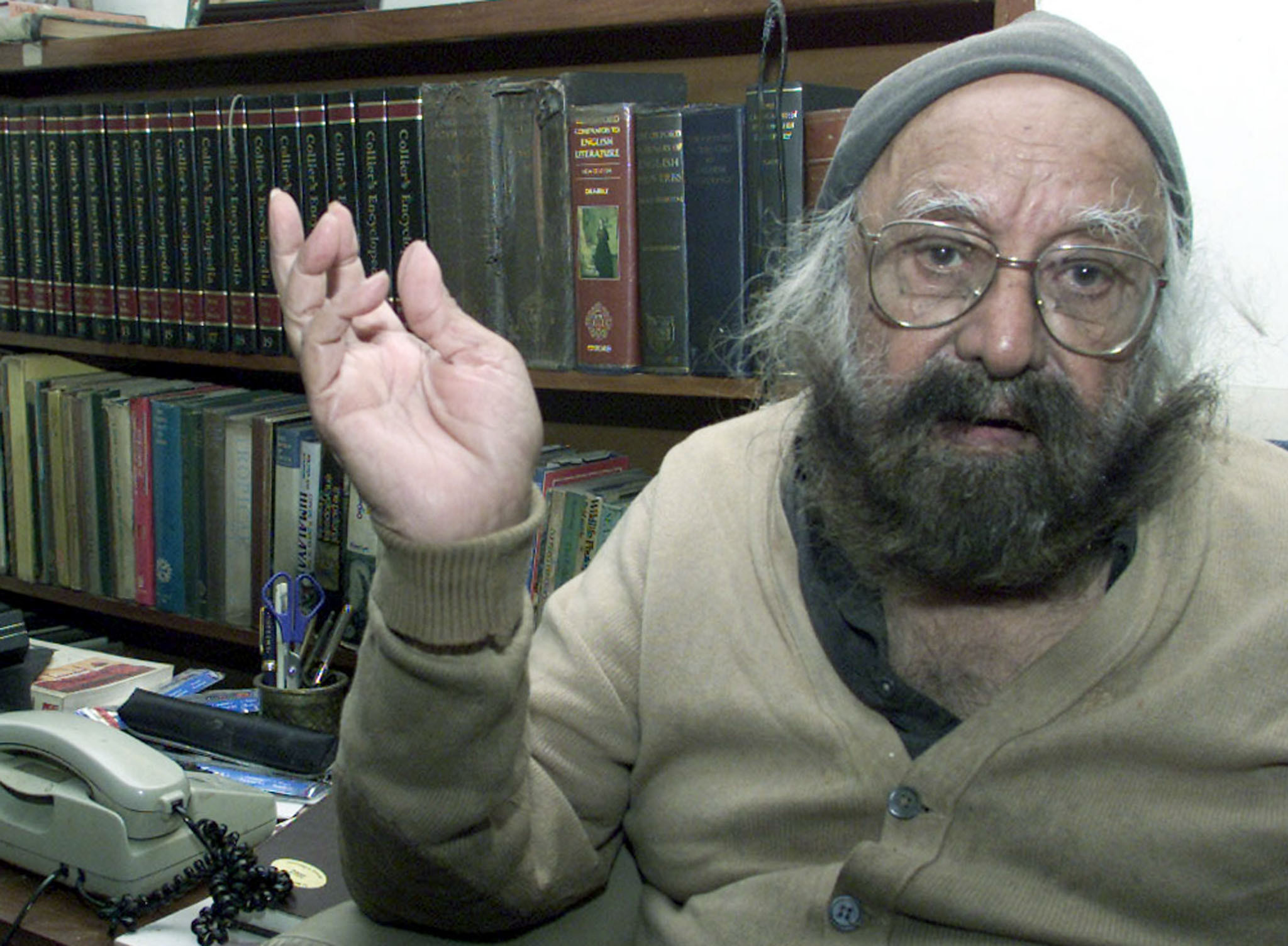Khushwant Singh, India's best known columnist, speaks to Reuters duringan interview in New Delhi. His friends call him the grand old man ofIndian literature, while critics dismiss him as just dirty old man.Picture taken February 15, 2002. REUTERS/Kamal KishoreJSG/TAN - RP3DRHYLYEAA