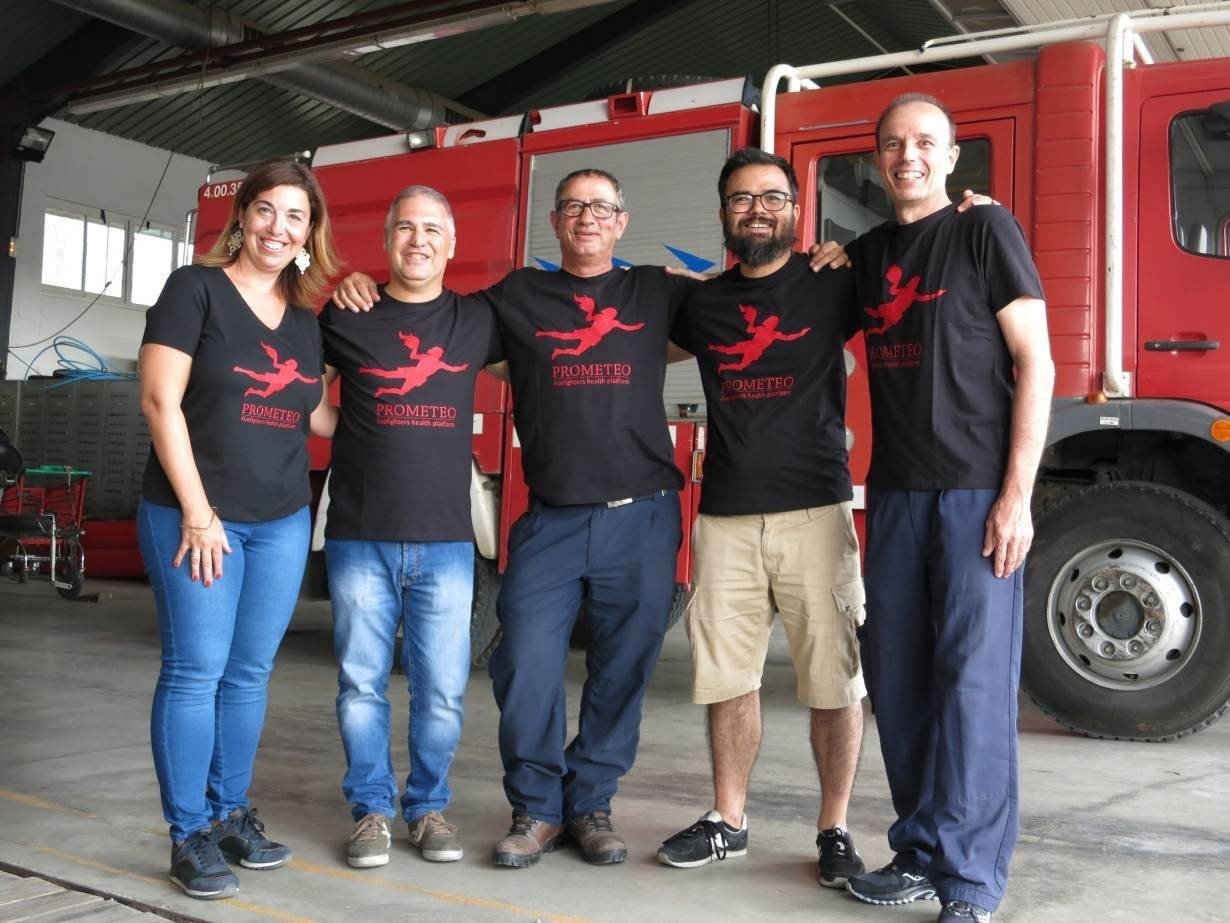 The Prometeo team pose for a picture in front of a fire engine (from left to right: Salomé Valero, Marco Rodriguez, Joan Herrera, Josep Ràfols, and Vicenç Ferrés Padró) in Catalonia, Spain.