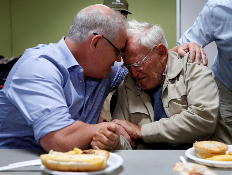 Australia's Prime Minister Scott Morrison comforts an elderly man in NSW.
