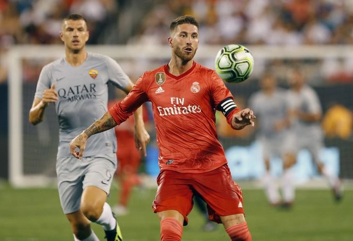 Aug 7, 2018; East Rutherford, NJ, USA; Real Madrid midfielder Sergio Ramos  (4) plays the ball against Roma forward Edin Dzeko (9) during an International Champions Cup soccer match at MetLife Stadium. Mandatory Credit: Noah K. Murray-USA TODAY Sports